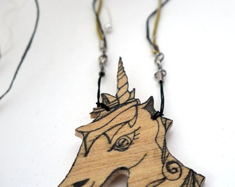 Wooden Unicorn, brooch and Mentajon
