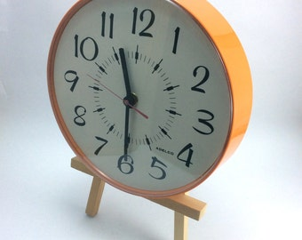 Funky orange circular Adelco battery powered wall clock