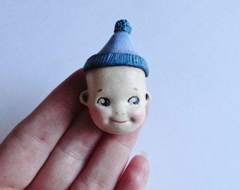 Kewpie Doll Brooch Pin - Cutie in a Bobble Hat