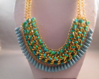 4 Row Bib Choker Necklace with Light and Dark Blue Beads one Gold Tone Chain Tied with Blue/Green Cord