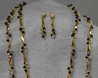 Faux Black and White Pearls in Goldtone