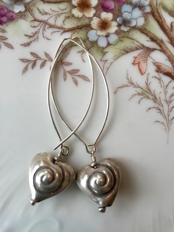 Sea Shell Love. Fine silver hearts on sterling earwires. Handmade by ladeDAH! Jewelry.