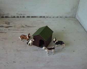 4 Vintage Dog Figurines and Miniature Dog House Cast Metal Lead Britains Ltd. Made in England