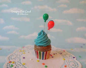 Fake Cupcake Chocolate Primary Colors Blue Frosting and Party Balloons Rainbow