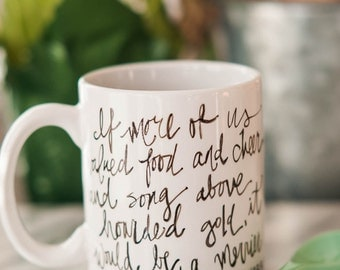 Mug Quote: If more of us valued food and cheer and song above hoarded gold, it would be a merrier world. By J.R.R. Tolkien from the Hobbit.