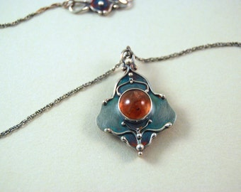Blood Quartz.  Sterling silver necklace with blood quartz cabochon.  Handmade.  One of a kind. Red. Rusted iron orange.
