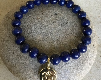 Lapis Lazuli Stone.Beaded Bracelet. Releases Stress. Self Confidence.  December Birthstone. Stretch.Gold Ohm Charm.  Throat/Third Eye Chakra