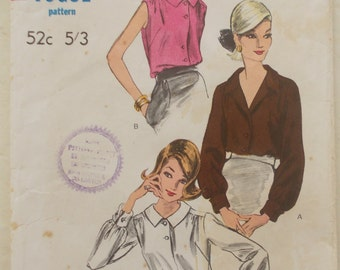 Vogue 6373 is for an early 1960s blouse with either long, cuffed sleeves or sleeveless. Size 32 inch bust.