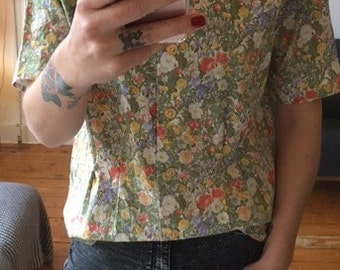 Vintage blouse with flowers and butterflies