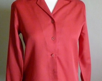 Long sleeved red blouse