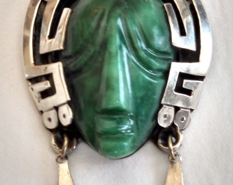 Mexican Taxco sterling silver and green onyx mask brooch / pendant