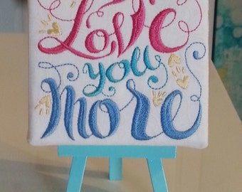 """Embroidered I Love You More Wall Hanging 4"""" x 4"""" with Matching Aqua Easel"""