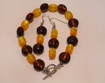 MK-10256 Love the rich color in the amber and brown beads in this bracelet and earring set! Very earthy tones that look good with anything!
