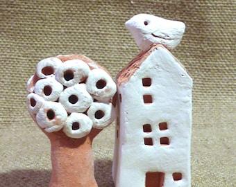Miniature ceramic houses and trees