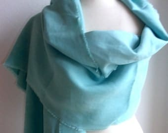 A shawl made in a linen bedsheet of the 1920s/1930. (France). Colored in turquoise/green.
