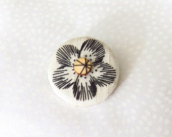 Black and white flower brooch, hand embroidery on silk.