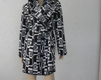 Ladies black and white waterproof raincoat with hood and belt