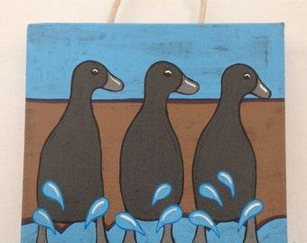 Running ducks canvas picture