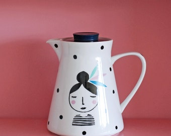 Large girl with feathers in her hair and dots screenprinted vintage teapot