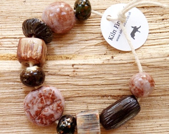Handmade beads ~ 10 unique ceramic and glass beads, porcelain stoneware clay  glass bead set, jewelry making, jewellery components hand made
