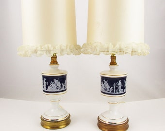 Greek Figures on Cobalt Blue  - Pair of White Ceramic Lamps - Gold Rings - Burnished Gold Bases and Tops - Satin Barrel Shades With Ruffle