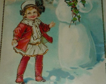 Cute Little GIrl in Red Coat With Snowman