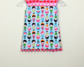 """Size 2 - Fully Reversible - """"Alexandra Dress"""" - Happy dolls and Rainbow dot with Pink Pom poms for extra fun"""