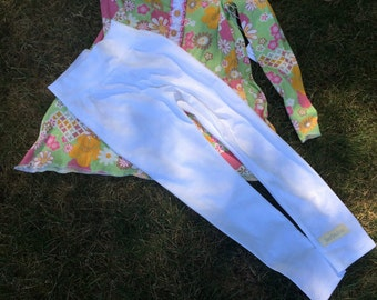 Pale green tunic top with white yoga pants