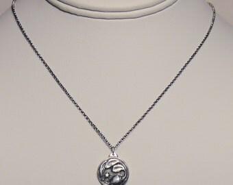 Silver cosmic beet pendant