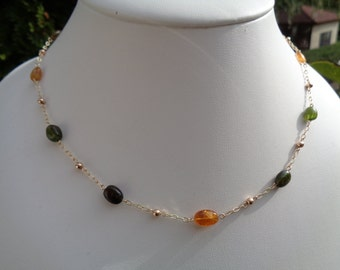 Chain gold tourmaline in warm light colours in 585-er