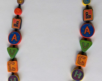 Laugh Storybook + Jewelry (Mixed media with polymer clay & seed beads)