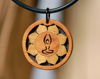 Yoga jewelry and handmade wooden pendant from an indialover. May peace prevail on earth.