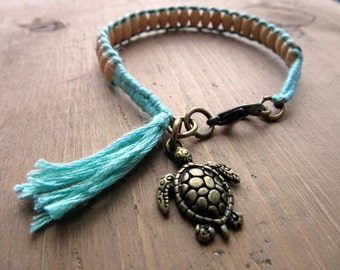 Bracelet of wooden beads, wires and antique bronze turtle charm