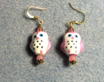Pink ceramic owl bead earrings adorned with pink Czech glass beads.