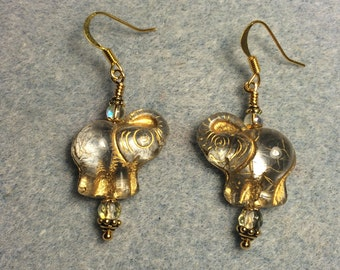 Clear Czech glass elephant bead dangle earrings adorned with clear Czech glass beads.