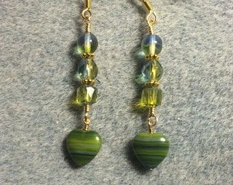 Blue green striped Czech glass heart bead dangle earrings adorned with blue green Czech glass beads.