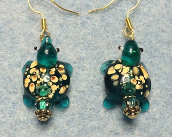 Spotted teal lampwork turtle bead earrings adorned with teal Czech glass beads.