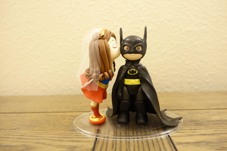 Super Girl and Batman Wedding Cake Topper