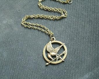 "Keychain / earrings/ Straps / Necklace '  Mockingjay """