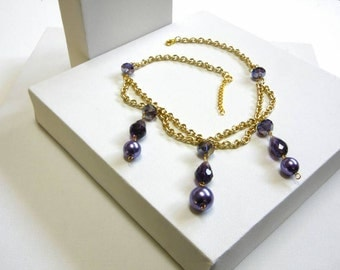 Purple necklace with glass pearls and faceted beads