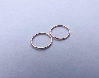 """New! """"Pink"""" Rose gold this listing is for a set of 2 Seamless Hoop Rings for Nose,Ear,Cartilage,Tragus,eyebrow,etc../Thin Snug/endless hoop"""