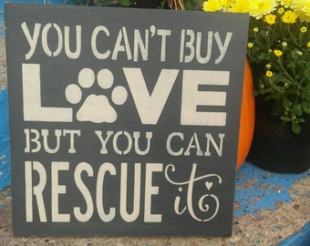 You can't buy love but you can rescue it, stenciled wood sign