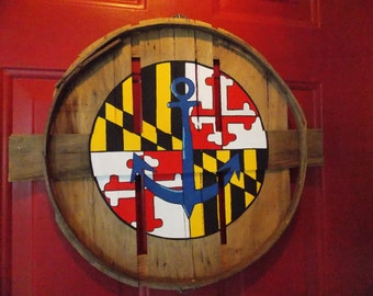 Maryland flag center circle with blue nautical anchor in middle. Hand painted on recycled crab bushel lid.