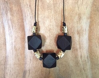 Black Geometric Bead Necklce with accent beads.