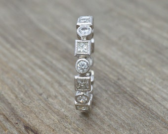 Diamonds and 14KT White Gold Eternity Ring 1.76tw