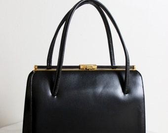 vintage BIRKS leather lined black structured handbag with gold hardware and suede interior
