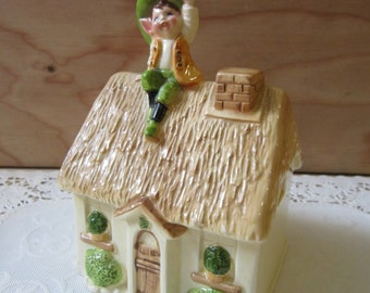 Vintage Gorham Japan Ceramic Coin Bank With Elf Sitting on a Thatched Cottage Rooftop