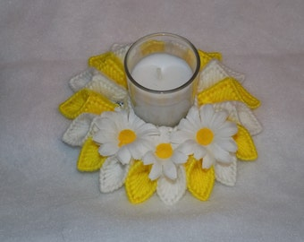 white and yellow candle holder