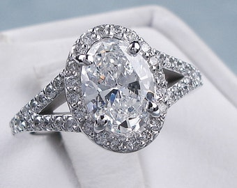 Beautiful 1.70 ctw Oval Cut Diamond Engagement Ring with a 1.22 Oval Cut D Color/SI1 Clarity Enhanced Center Diamond