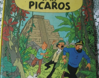 cartoon edition French tintin and the picaros 1976 edition published in Belgium by casterman.